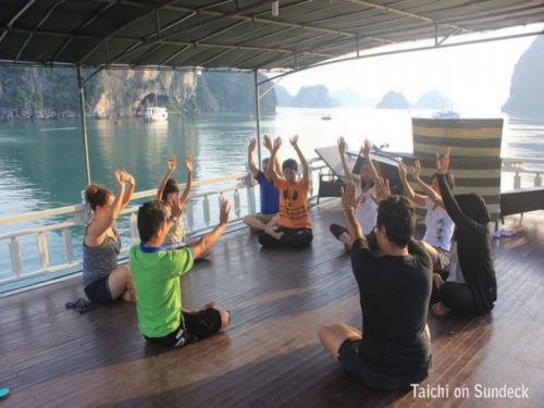 legacy-cruise-halong-bay-cruise_Taichi-on-sundeck